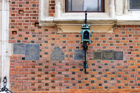 assumed: Lantern hanging off the wall of St. Mary Basilica and memorial plaques Stock Photo