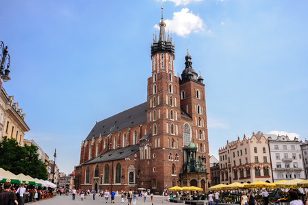 main market: KRAKOW, POLAND - JULY 2, 2009: St. Mary Cathedral at the grand square (aka main market square) Editorial