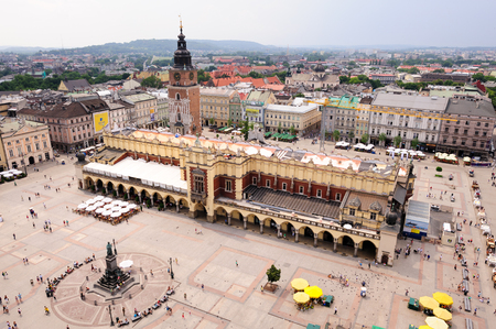 main market: KRAKOW, POLAND - JULY 2, 2009: Adam Mickiewicz monument, Cloth Hall and Town Hall Tower at the Grand Square (aka Main Market square) viewed from St. Mary Cathedral tower
