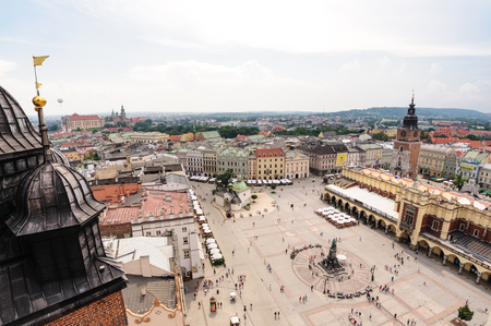 mickiewicz: KRAKOW, POLAND - JULY 2, 2009: Adam Mickiewicz monument, Cloth Hall and Town Hall Tower at the Grand Square (aka Main Market square) viewed from St. Mary Cathedral tower