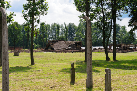 birkenau: Auschwitz II - Birkenau crematorium II ruins with the collapsed eastern wing roof in the center and the oven area and chimney wing on the right