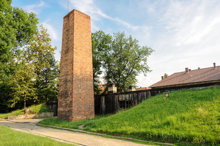 configurations: Auschwitz I - Birkenau Crematorium chimney is a reproduction and its current appearance does not exactly match any of its wartime configurations Editorial