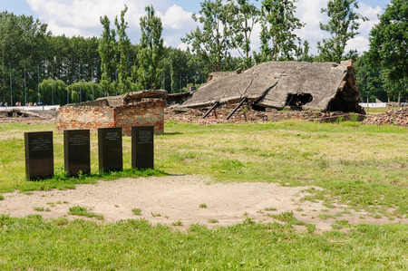 whose: Auschwitz II - Birkenau, roof of the eastern wing of Crematorium II and memorial plaques dedicated to those whose ashes lie in the pit behind the plaques Editorial