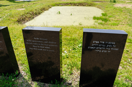 death camp: Auschwitz II - Birkenau memorial plaques in front of an ashes pit next to the Crematorium II