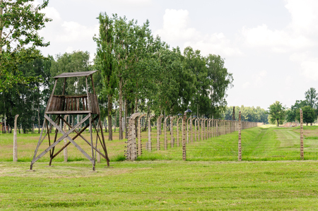 birkenau: Auschwitz II - Birkenau, aspect of the electrified barbed wire fence and watch tower Editorial
