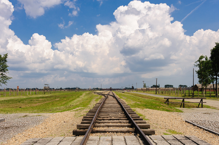 death camp: Auschwitz II - Birkenau, view from the end of the tracks at the International monument towards the Gate of Death, 1 mile away