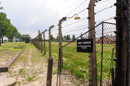 death camp: Auschwitz II - Birkenau, Sector I outer perimeter electrified fence and watch tower