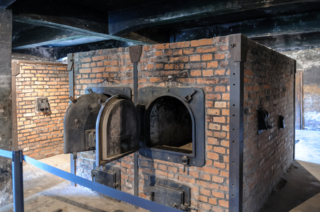 crematorium: OSWIECIM, POLAND - JULY 3, 2009: Auschwitz I - Birkenau ovens and equipment in the crematorium are all reproductions, representing double-muffle single-door ovens Editorial