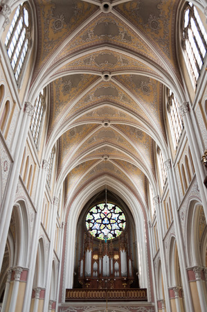 the vaulted: RADOM, POLAND - JULY 4, 2009: Holy Virgin Mary Cathedrals dominant rosette with stained glass above the organ and vaulted ceiling