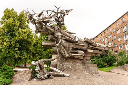 nike: GDANSK, POLAND - JULY 6, 2009: Defenders of the Polish Post Office monument designed by Wincenty Kucma represents a dying Polish post employee being handed a rifle by Nike a little too late