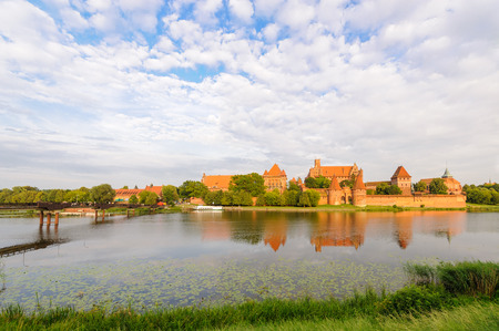 teutonic: Teutonic German order Malbork Castle at sunset from across the Nogat river