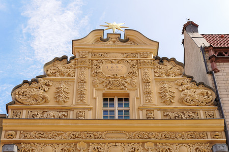 stare miasto: TORUN, POLAND - JULY 7, 2009: Gable of the house under the star, a building styled with baroque ornaments on 35 Rynek Staromiejski at the old town square Editorial