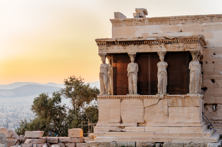 caryatids: ATHENS, GREECE- AUGUST 6, 2009: The Erechtheion temples south porch with copies of the karyatides at the Acropolis Editorial