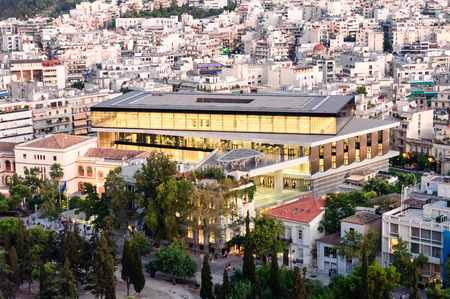 acropolis: ATHENS, GREECE- AUGUST 6, 2009: Cityscape with the New Acropolis museum building illuminated at dusk as viewed from the Acropolis Editorial