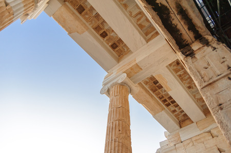 restored: ATHENS, GREECE- AUGUST 6, 2009: Restored beams, coffers and ionic capital of the Acropolis Propylaea