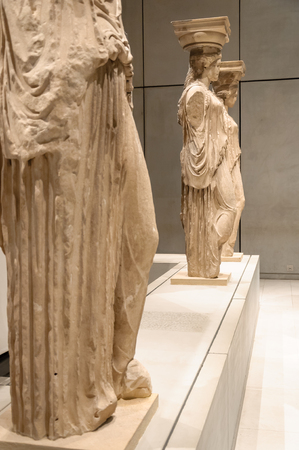 caryatids: ATHENS, GREECE - JANUARY 28, 2011: Restoration and conservation work on the Caryatids at the New Acropolis Museum. The one Caryatid missing from the platform taken by Lord Elgin.