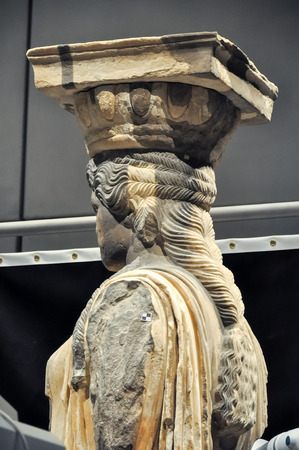 caryatids: ATHENS, GREECE - JANUARY 28, 2011: Restoration and conservation work on the Caryatids at the New Acropolis Museum. Conservator using laser to remove surface contamination. Partially completed side view.