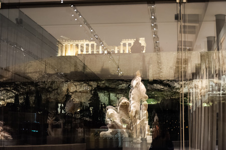 pediment: ATHENS, GREECE - JANUARY 28, 2011: Reflections of a pediment against the glass window on the 3rd level of the New Acropolis Museum, at night