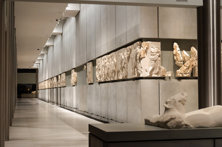 friso: ATHENS, GREECE - JANUARY 28, 2011: Frieze on the 3rd level of the New Acropolis Museum, at night with no people Editorial