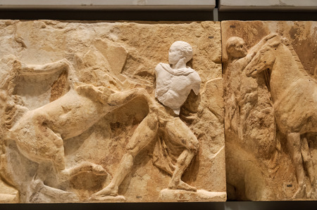 new addition: ATHENS, GREECE - JANUARY 28, 2011: West frieze entablature No. 14 (XIV) on the 3rd level of the New Acropolis Museum at night. The plaster replica addition is a piece Lord Elgin removed. Editorial