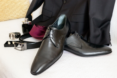 stylish men: ATHENS, GREECE - OCTOBER 25, 2015: Arrangement of mens stylish and elegant accessories next to a suit