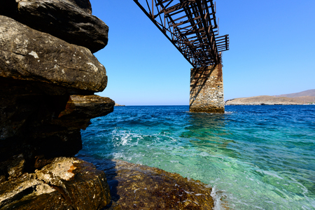 gantry: Old gantry at Loutra, Kythnos, Greece for loading iron ore from the mines