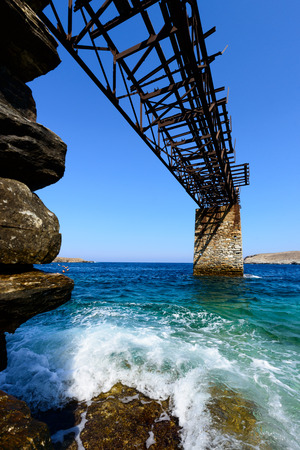 kyklades: Old gantry at Loutra, Kythnos, Greece for loading iron ore from the mines