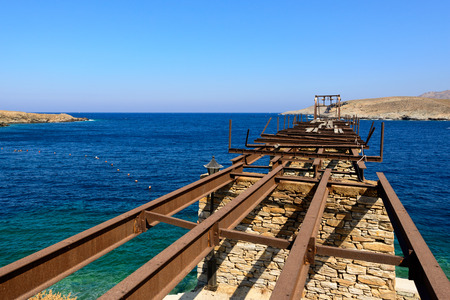 kyklades: Old gantry projecting out to sea at Loutra port in Kythnos, Greece