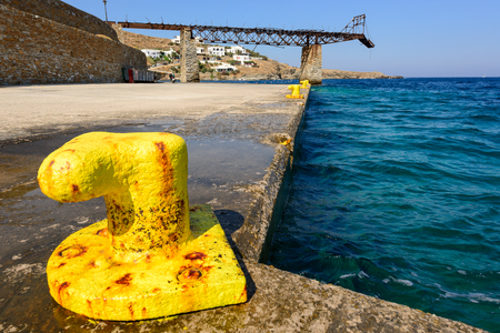 rusting: Old gantry and a rusting bollards at Loutra port in Kythnos, Greece Stock Photo