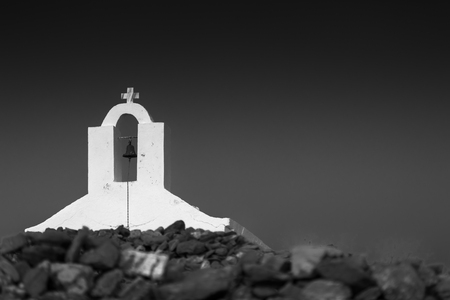 kyklades: Typical belfry over the entrance of a chapel at a remote location in Kythnos, Greece