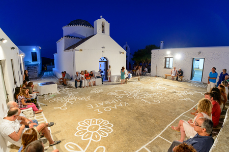 liturgy: KYTHNOS, GREECE - AUGUST 14, 2014: People waiting for the Assumption eve liturgy to commence at the church of Panagia Stratolatissa