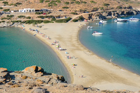 opposing: KYTHNOS, GREECE - AUGUST 12, 2014: The Kolona double sided beach at Kythnos, Greece as viewed from Aghios Loukas islet Editorial