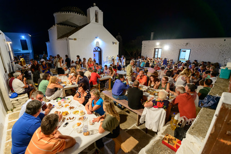 feast: KYTHNOS, GREECE - AUGUST 14, 2014: People gathering to celebrate and feast on Assumptions eve at the church of Panagia Stratolatissa Editorial