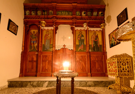kyklades: KYTHNOS, GREECE - AUGUST 14, 2014: Vigil light burning in front of the iconostasis (templon) in the chapel next to the church of Panagia Stratolatissa