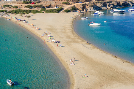kyklades: KYTHNOS, GREECE - AUGUST 12, 2014: The Kolona double sided beach at Kythnos, Greece as viewed from Aghios Loukas islet Editorial