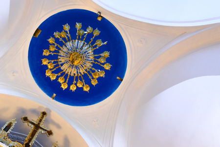 iconostasis: KYTHNOS, GREECE - AUGUST 14, 2014: Chandelier hanging from the cupola and the iconostasis cross, at the church of Panagia Stratolatissa
