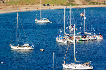 kyklades: KYTHNOS, GREECE - AUGUST 12, 2014: Sailing boats raft-up at Fykiada beach next to Kolona beach Editorial