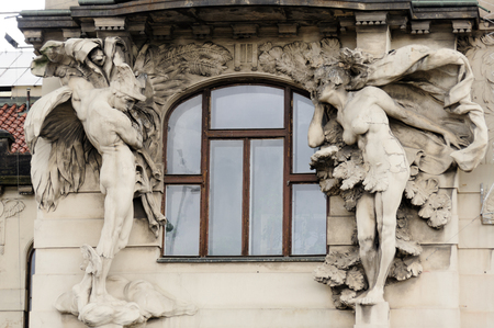 telamon: PRAGUE, CZECH REPUBLIC - JULY 8, 2009: Relief close-up of a telamon and a caryatid statue on a facade of a building