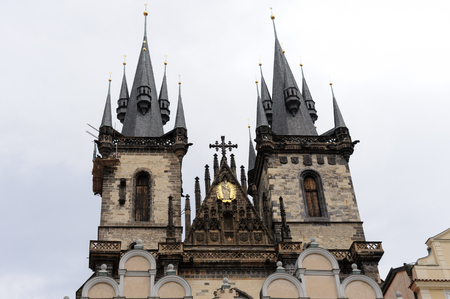 spires: PRAGUE, CZECH REPUBLIC - JULY 8, 2009: Church of Mother of God before Tyn with the two gothic spires and the golden relief of Virgin Mary