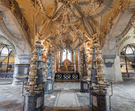 KUTNA HORA, SLOVAKIA - JULY 8, 2009: Sedlec Ossuary (aka Church of Bones) beneath the Cemetery Church of All Saints, contains over 40,000 skeletons whose bones are artistically arranged as decorations Redakční