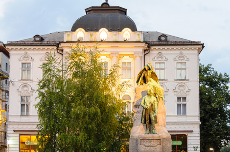 muse: LJUBLJANA, SLOVENIA - JULY 9, 2009: Historicist bronze statue of the Slovene national poet France Preseren with a muse holding a laurel wreath, in front of the Central Pharmacy building Editorial