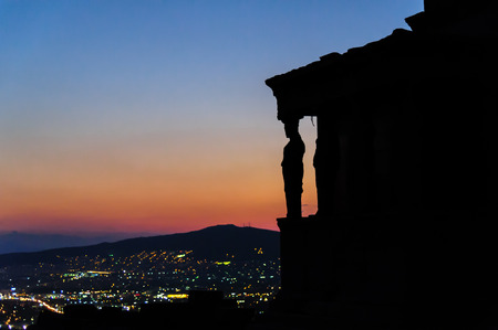 caryatids: Silhouettes of the Karyatides at sundown, on the Erechtheion temples south porch, at the Acropolis