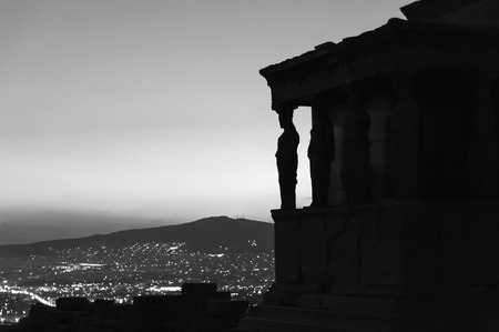 caryatids: ATHENS, GREECE- AUGUST 6, 2009: Silhouettes of the Karyatides on the Erechtheion temples south porch, at the Acropolis