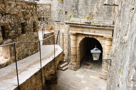 parapet wall: Kotor old town medieval fortification ramparts and defensive outer walls Stock Photo