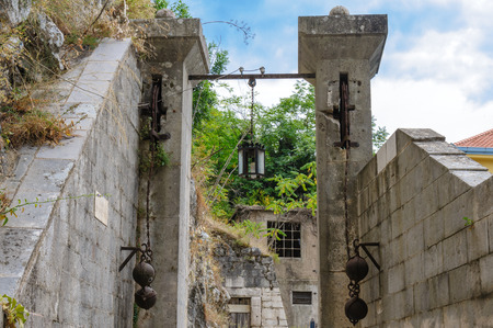 portcullis: Gurdic gate and portcullis at the south entrance of Kotor old town Stock Photo