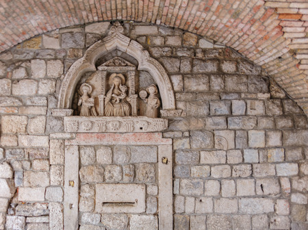 15th century: 15th century gothic sculptural bas-relief at the Sea Gate of the Kotor old town Stock Photo