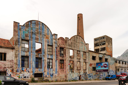 sustained: KOTOR, MONTENEGRO - AUGUST 30, 2009: An abandoned factory that sustained major damage after the 1979 earthquake