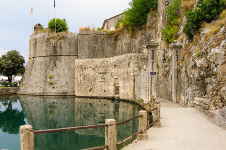 portcullis: Gurdic gate with portcullis and moat at the south entrance of Kotor old town