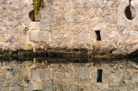 slits: Kotor old town moat and defensive walls with loophole arrow slits Stock Photo