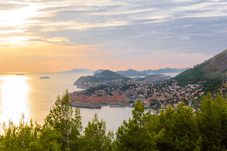 birdseye: Birds-eye view of Dubrovnik old city from the east at sunset and Dalmatian islands in the distance